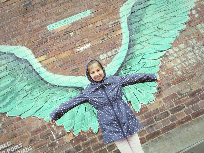 These wings were made to fly Childhood Looking At Camera Portrait One Person Girls Elementary Age Smiling Child Happiness Real People Children Only Day Cute People Street Art Graffiti Art Graffiti Statement Jamaica Street Liverpool Wings Angel Paul Curtis Artwork