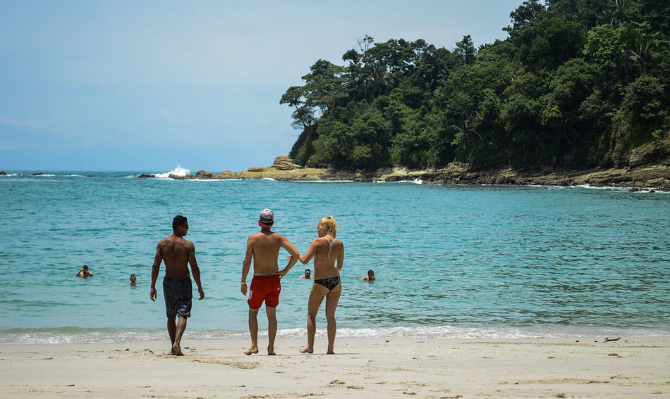 Manuel Antonio Manuel Antonio National Park Costa Rica 🇨🇷 Manuel Antonio Park Beach Beauty In Nature Day Horizon Over Water Leisure Activity Lifestyles Nature Outdoors People Real People Rear View Sand Scenics Sea Shirtless Standing Summer Travel Destinations Tree Vacations Water
