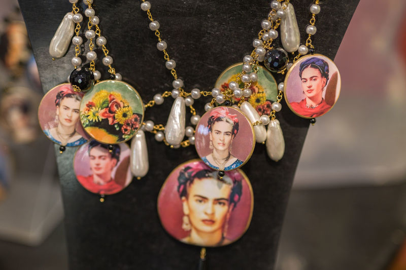 Close-up of necklace with photographs