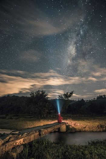 Lost In The Landscape Astronomy Beauty In Nature Flashlight Galaxy Long Exposure Milky Way Nature Night No People Outdoors Red Scenics Sky Star - Space Water See The Light