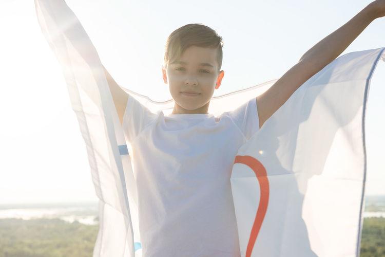 Portrait of boy holding flag