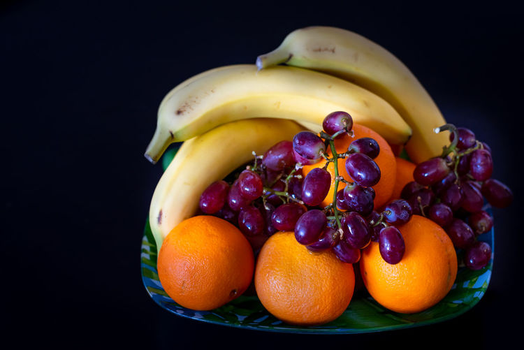 Fruit Healthy Eating Food Food And Drink Wellbeing Freshness Banana Still Life Studio Shot Orange - Fruit Indoors  Orange Orange Color No People Citrus Fruit Black Background Close-up Variation Choice Yellow Ripe Fresh Fruits Weightloss