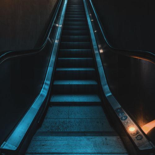 Staircase of illuminated escalator