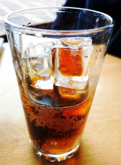 A cool drink Ice Drink Drinking Glass Refreshment Refresh Eyeem Drinks Huawei P20 Pro EyeEm Gallery Drink Cold Temperature Cola Drinking Glass Ice Cube Table Close-up Food And Drink Carbonated Soda Dissolving