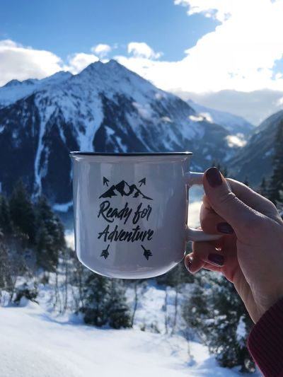 Ready for adventure? ❄️🏔⛷ Coffee Cup Ready For Adventure Winter Ready For Winter Adventure Time Adventure Human Hand Mountain Hand Snow Cold Temperature Winter Human Body Part Snowcapped Mountain Beauty In Nature Holding Text It's About The Journey