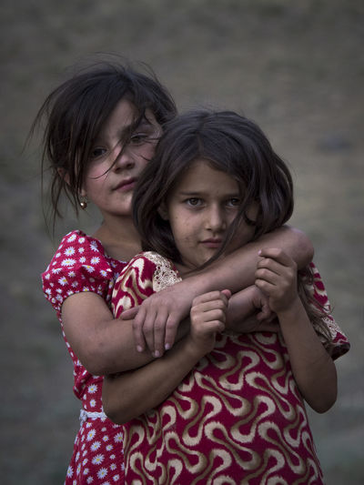 Two curious girls looking at the camera as when we arrived in Lyaksh, Tajikistan EyeEmNewHere Bonding Casual Clothing Child Childhood Females Girls Looking At Camera Love People Portrait Portrait Photography Positive Emotion Real People Sister Togetherness Two People Women The Photojournalist - 2018 EyeEm Awards The Portraitist - 2018 EyeEm Awards 50 Ways Of Seeing: Gratitude Human Connection #NotYourCliche Love Letter