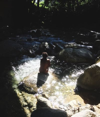Young girl bathing in river One Person Water Real People Lifestyles Leisure Activity Nature Low Section Human Body Part High Angle View Sunlight Women Land Human Leg Day Sea Outdoors Body Part Relaxation Motion