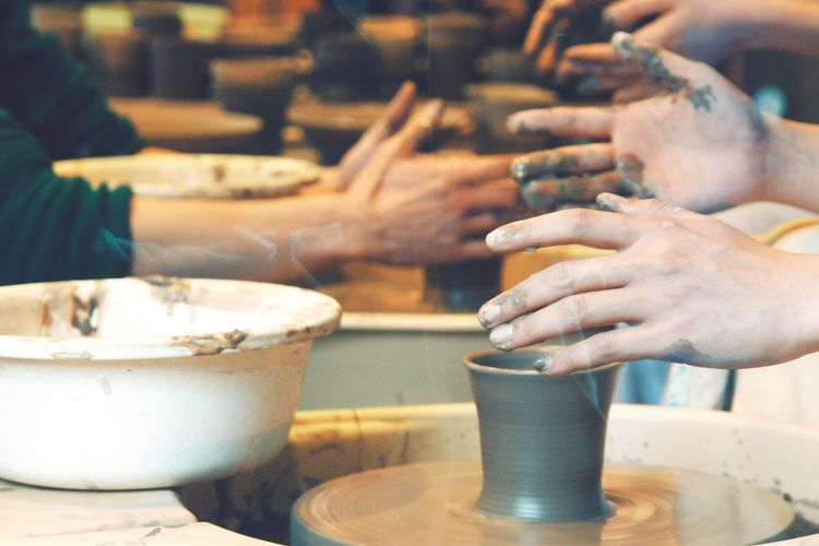 People Making A Bowl In Pottery Class