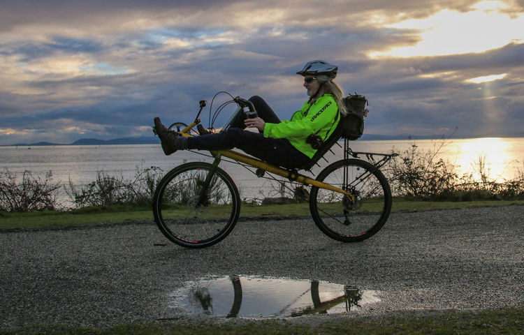 I am riding my recumbent bicycle through Garry Point Park in the area of Steveston, located in Richmond, BC. The body of water is the Salish Sea, Straight of Georgia, Pacific Ocean. The clouds are covering the mountains of Vancouver Island. Bicycle Cloud - Sky Garry Point Park Land Vehicle Men Mode Of Transport Pacific Ocean Recumbent Bicycle Richmond, Bc Scenics Sea Steveston Sunset Transportation Water