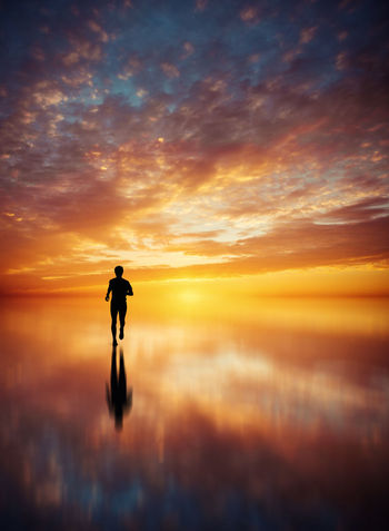 Adult Beauty In Nature Full Length Men Nature One Man Only One Person Only Men Orange Color Outdoors People Scenics Sea Silhouette Sky Sunset Tranquil Scene Tranquility Water