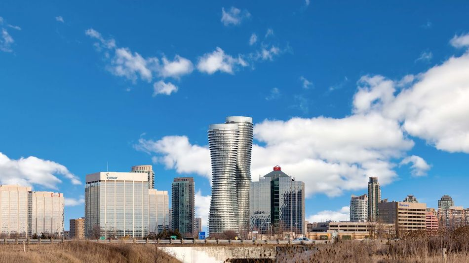 MISSISSAUGA, CANADA - MARCH 30, 2018: Beautiful Panoramic View of the Absolute World Residential twin tower buildings in the city Absolute Towers Mississauga, Canada Toronto Architecture Blue Building Building Exterior Built Structure City Cityscape Cloud - Sky Day Financial District  Landscape Modern Nature No People Office Office Building Exterior Outdoors Sky Skyscraper Tall - High Tower Urban Skyline