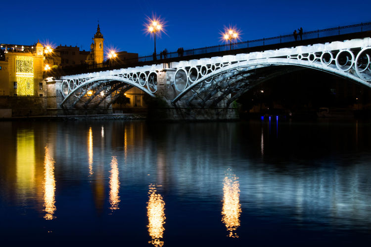 Architecture Built Structure Bridge Connection Bridge - Man Made Structure Water Illuminated Reflection Night Arch Transportation City River Waterfront Travel Destinations Building Exterior Sky Arch Bridge Nature No People Outdoors Light