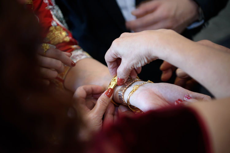 Close-Up Of Hands During Wedding Ceremony