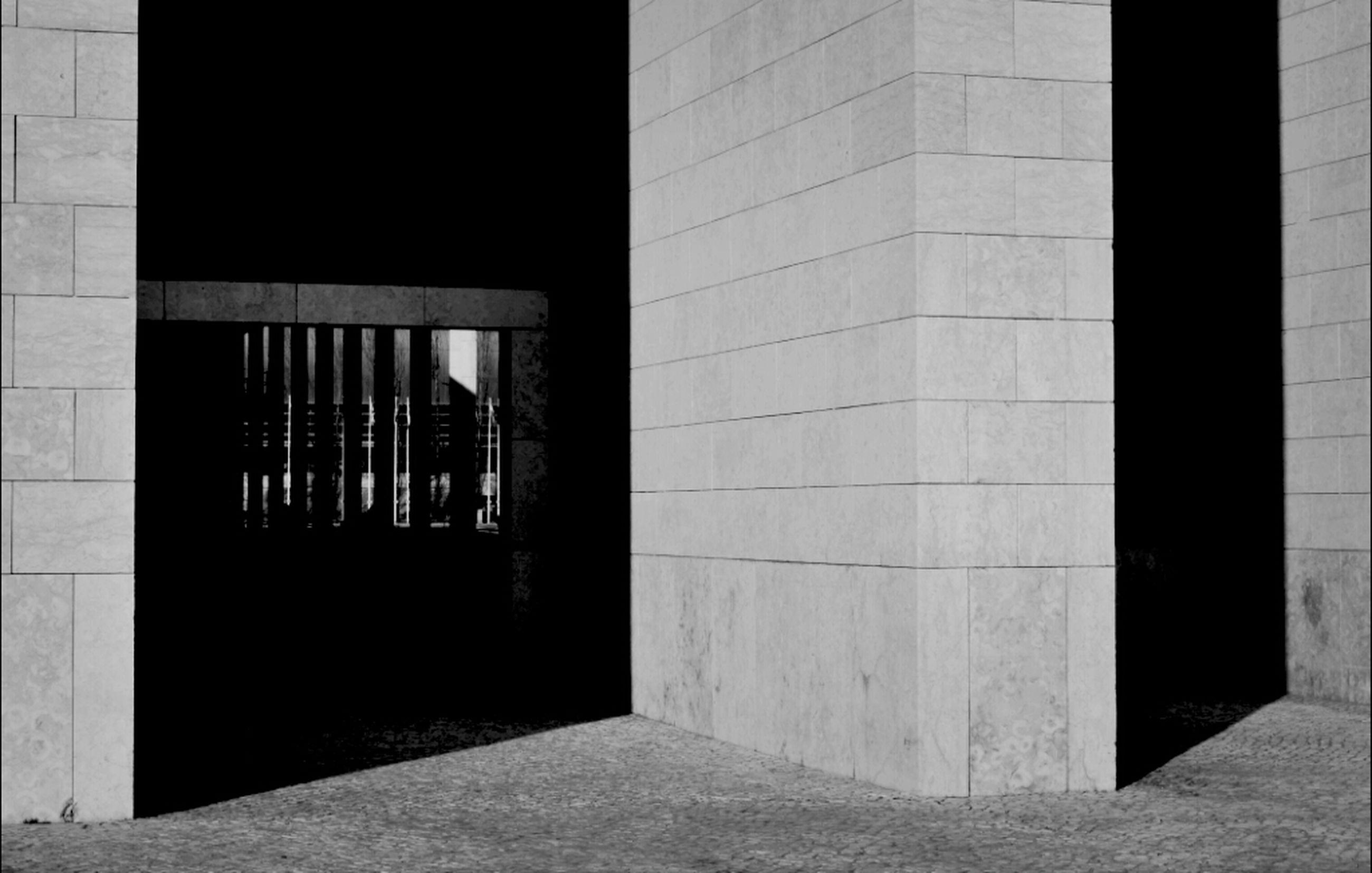 architecture, built structure, building exterior, window, building, city, wall - building feature, sunlight, shadow, indoors, door, day, wall, men, corridor, entrance, residential building, residential structure