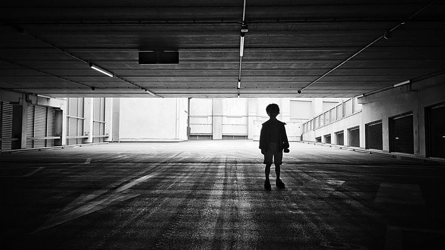 Boy Standing In Parking Garage