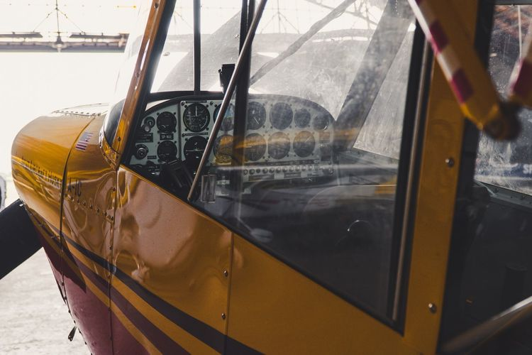 Airplane Interior Airplane Plane Plane Interior Mode Of Transportation Yellow Transportation No People Day Glass - Material Outdoors Land Vehicle Public Transportation Metal Wheel Travel