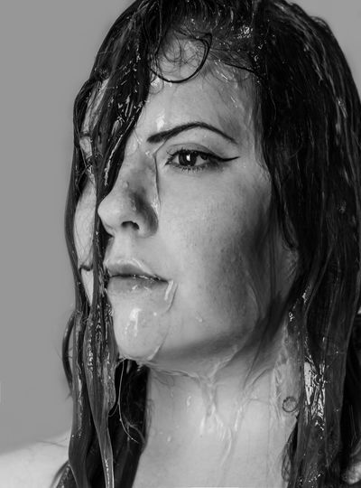 Close-up of thoughtful wet woman