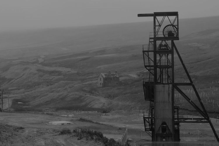 Architecture Built Structure Coal Mine Day Environment Fog Fuel And Power Generation Industrial Equipment Industry Landscape Machinery Manufacturing Equipment Mine Mining Nature No People Non-urban Scene Observation Point Oil Well Outdoors Safety Sky