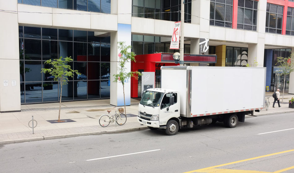Photo of a delivery van. Delivery Van Land Vehicle Lorry Minivan Transit Transport Truck Trucking Van