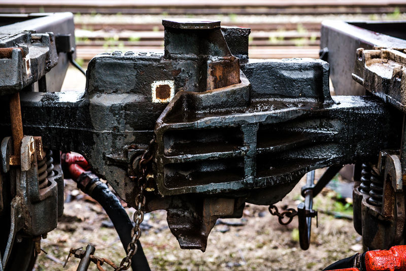 Train coupler close-up Fasten Machinery Part Of Transport Transportation Connection Coupler Day Detail Fragment Land Vehicle Locomotive Nobody Old Outdoors Outside Rail Railway Railway Track Rusty Steel Train Train - Vehicle Truck Vehicle