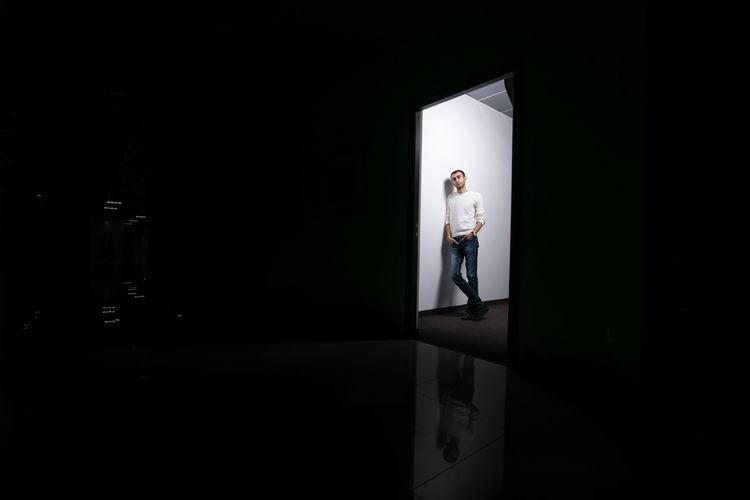 Full length of man standing at doorway