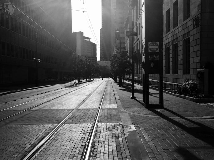 Downtown Downtown Blackandwhite Streetphotography Dallas Dallas Tx Transportation Roads Street Street Photography The City Light Track Railroad Track Rail Transportation Built Structure Transportation Mode Of Transportation Nature Building Exterior Architecture City Life Day Outdoors Public Transportation Building Sign No People Sky Direction City