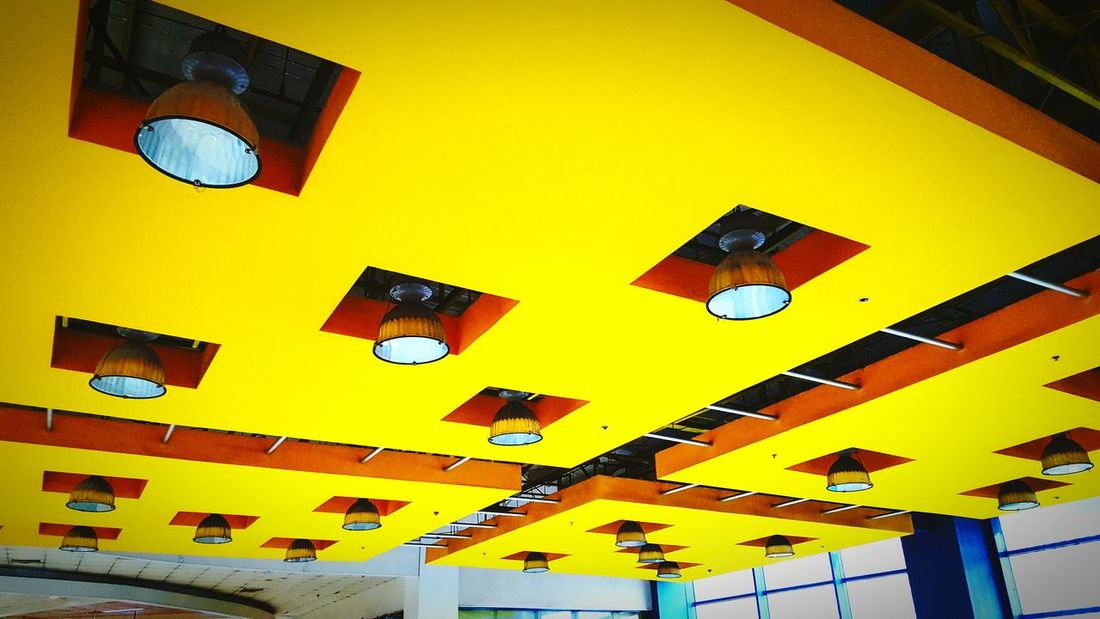 Saturated ceilings (samsung s6 shot) Yellow Architecture Built Structure Building Exterior Low Angle View City Window Modern Office Building Architectural Feature Vibrant Color Geometric Shape Day Outdoors City Life No People Multi Colored Low Angle View Non-urban Scene Sunlight