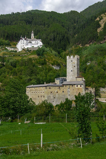Abbey Alto Adige Burgeis Castle Architecture Building Building Exterior Built Structure Burgusio Day Green Color Growth Italy Land Mountain Nature No People Outdoors Plant Religion South Tyrol Travel Destinations Tree Val Venosta Vinschgau