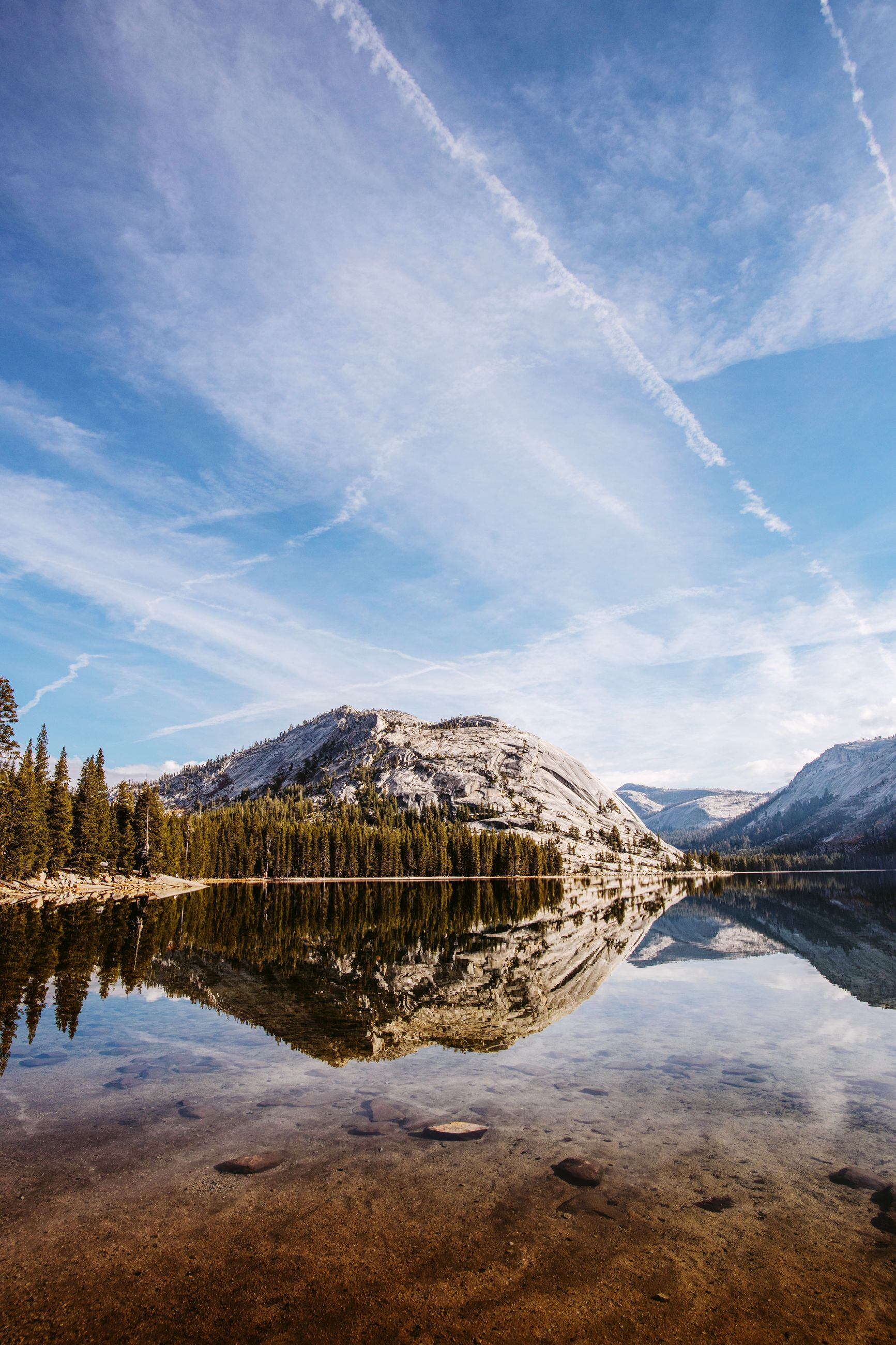 water, reflection, lake, sky, mountain, beauty in nature, scenics - nature, cloud - sky, tranquility, tranquil scene, non-urban scene, no people, nature, mountain range, day, rock, idyllic, rock - object, environment, outdoors, vapor trail