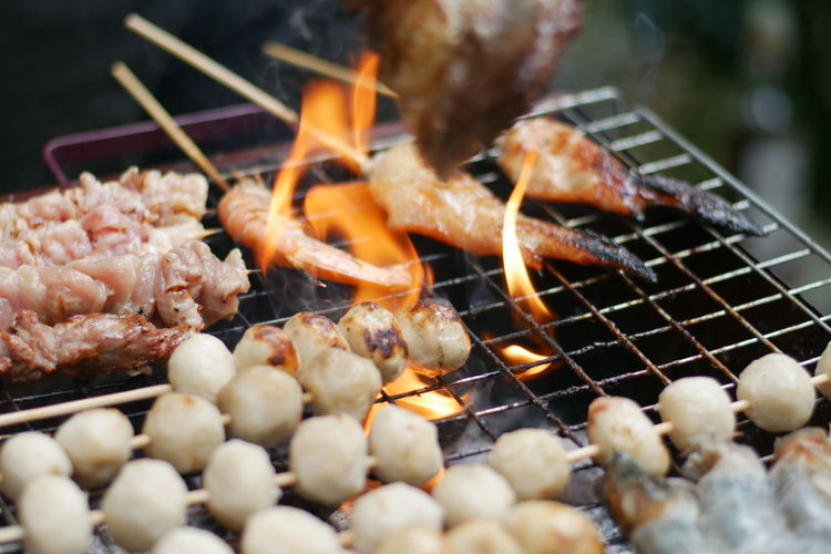 Grill food Food And Drink Food Meat Barbecue Heat - Temperature Freshness Barbecue Grill Selective Focus Close-up Grilled No People Preparation  Skewer Fire Burning Healthy Eating Fire - Natural Phenomenon Wellbeing Flame Still Life Preparing Food Temptation Snack
