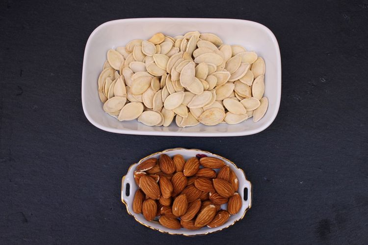 Close-up of pumpkin seeds and almonds