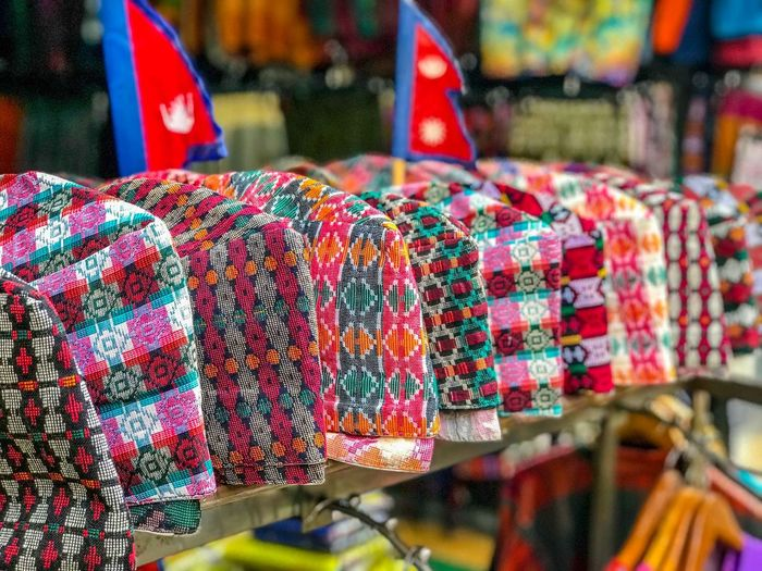 Shop in Thamel, Kathmandu Nepal selling Dakha Topi (Nepali Topi), the traditional male headwear. Traditional Clothing Close-up Clothing For Sale Large Group Of Objects Multi Colored Pattern Street Market