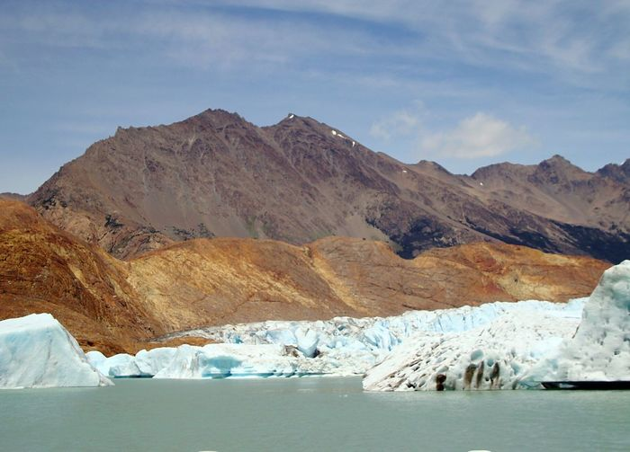 Scenic View Of Glacier With Mountains In Background