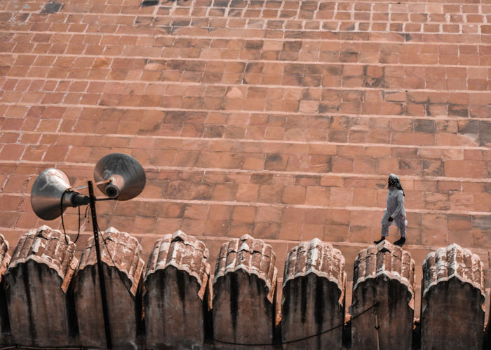 High angle view of man walking at mosque