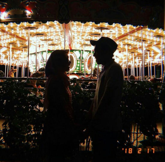 Side view of silhouette people at amusement park