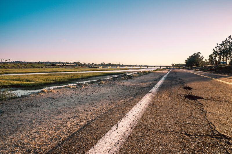 Our roads will have some potholes. SONY A7ii Sel2470gm Leading Lines Road Ocean Low Tide Wetlands San Diego California Bridge