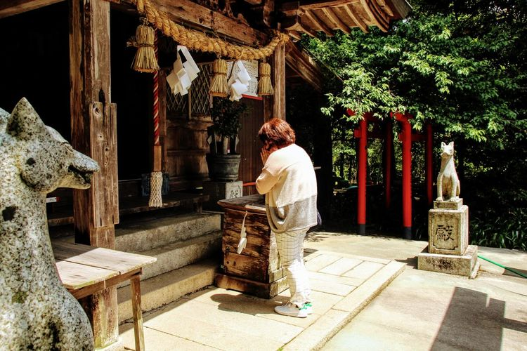She prays to God of Harvests. Inari Shrine Japan Japanese  Japanese Culture Japanese Shrine Pray Praying Praying For Happiness Shrine Woman EyeEmNewHere Tradition Wife Women Around The World