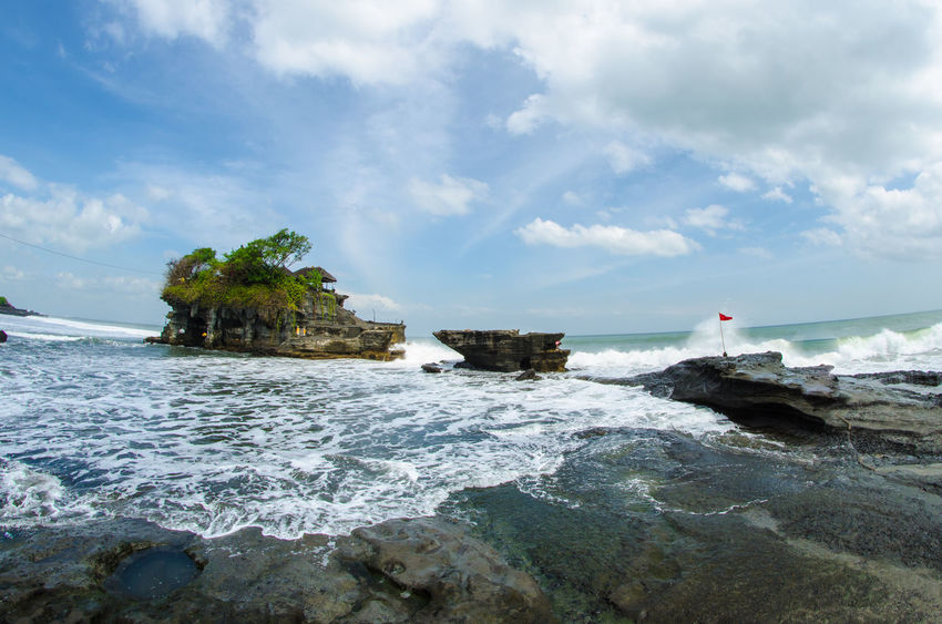 Beauty In Nature Buddhist Temple Cloud Cloud - Sky Coastline Day Horizon Over Water Idyllic Nature Non-urban Scene Outdoors Remote Rock Rock - Object Rock Formation Scenics Sea Shore Sky Tanah Lot Tranquility Water Wave