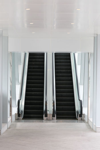 escalator in the mall and have path way to up and down. Escalators Absence Arcade Architecture Building Built Structure Ceiling Corridor Day Door Down Empty Entrance Escalator Escalators And Steps Flooring Indoors  Lighting Equipment No People Path Way Staircase Steps And Staircases Tool Up White Color