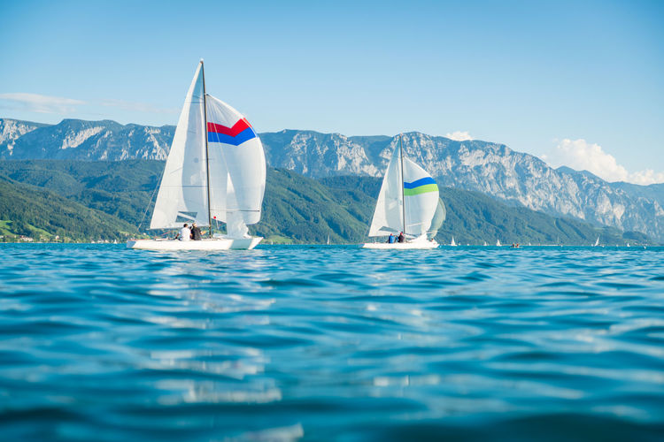 Sailboats on beautiful lake attersee in austria.