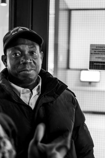 FLASH NEWS- the security guard, every people on the line wanted to say hello to him . Legalizeit Streetphotographers Journalism Notes From The Underground Photography Blackandwhite Photography Crowded EyeEm Best Shots Streetphoto Blackandwhite Portrait Photography Film Fuji FUJIFILM X-T2 Fujifilm_xseries Fujifilm Streetphoto_bw Streetphotography_bw Streetphotography Montréal Photojournalism Portraiture Portrait Photography portrait of a friend One Person Clothing Looking At Camera Real People Men Mature Adult