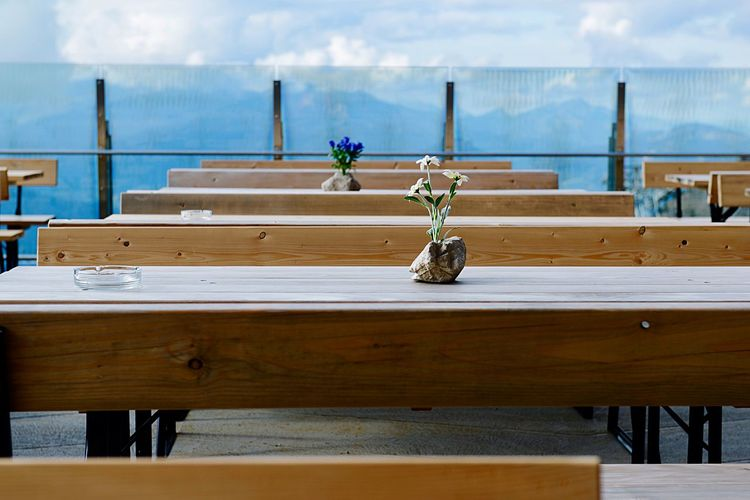 Tables And Benches Arranged In Cafe