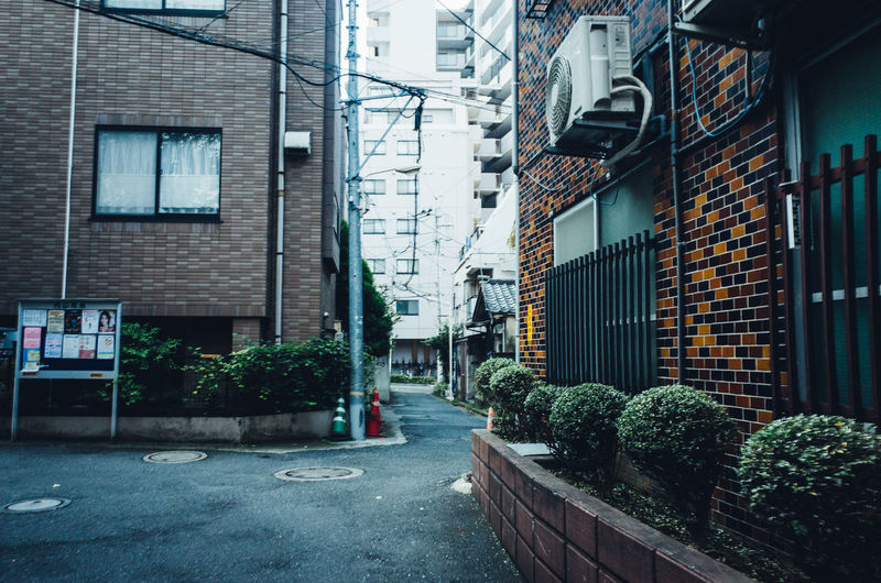 Backstreets & Alleyways Daytime Japan Japan Lovers Japanese Culture Morning Old Meets New Shibuyascapes TOKYO TOKYO Old Meets New The Changing City Tokyo Urban Exploration Alley Architecture Building Exterior Built Structure City Day Growth Nature No People Outdoors Plant Residential Building Tranquil Scene Water Window