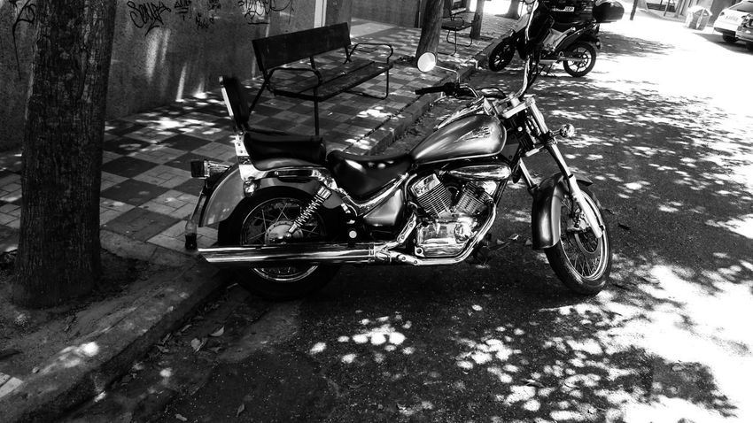 Motorcycle Bicycle Black And White Blackandwhite City Day High Angle View Land Vehicle Lifestyles Low Section Mode Of Transportation Monochrome Motor Vehicle Motorcycle on the move Outdoors Road Stationary Street Transportation Travel