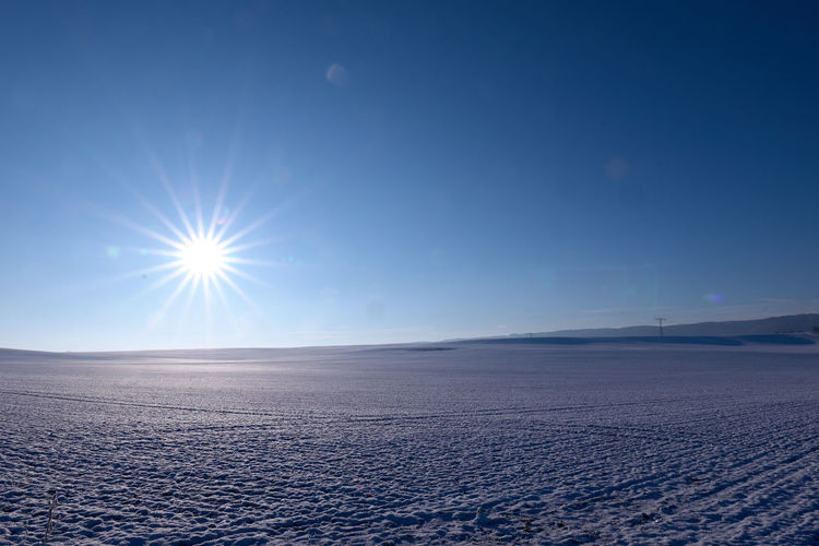 Arid Climate Beauty In Nature Blue Bright Brightly Lit Clear Sky Cold Temperature Copy Space Environment Idyllic Landscape Lens Flare Nature No People Non-urban Scene Outdoors Salt Flat Scenics - Nature Sky Sun Sunbeam Sunlight Tranquil Scene Tranquility