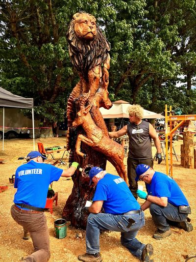 Applying last minute varnish Chainsaw Art AMPt Community Wood Carving Art IPhoneography Ryan Cook