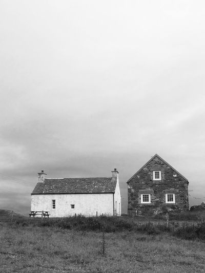 An atmospheric day out in Gigha Agricultural Building Agriculture Architecture Blackandwhite Building Exterior Built Structure Cloud - Sky Day Farmhouses Grass House Nature No People Old Buildings Outdoors Scotland Scottish Buildings Sky Stone Buildings Whitewashed