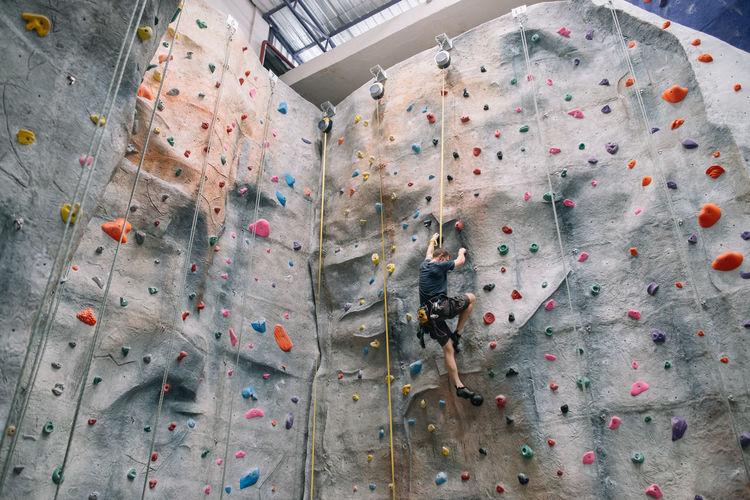 Indoor Rock Climbing Adventure Athlete Balance Challenge Climbing Climbing Wall Determination Equipment Exercising Extreme Sports Gym Health Club Healthy Lifestyle Indoor Rock Climbing Indoors  Leisure Activity Recreational Pursuit Rock Climbing Sport Strength