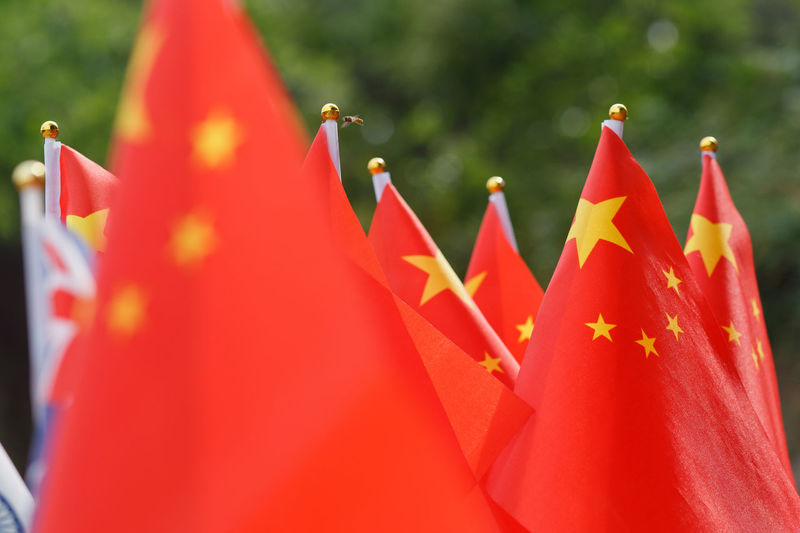 Close-up of chinese flags