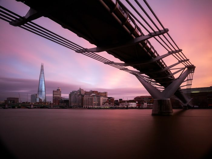 Under the bridge Sunset Bridge - Man Made Structure City Night Architecture Sky Built Structure Skyscraper Outdoors River London Millennium Bridge Urban Skyline Harbor Cloud - Sky Romantic Sky Low Angle View Cityscape Connection Water